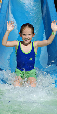 Girl on water slide at emerald hills golfland in san jose