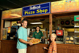 family buying pizza at golfland