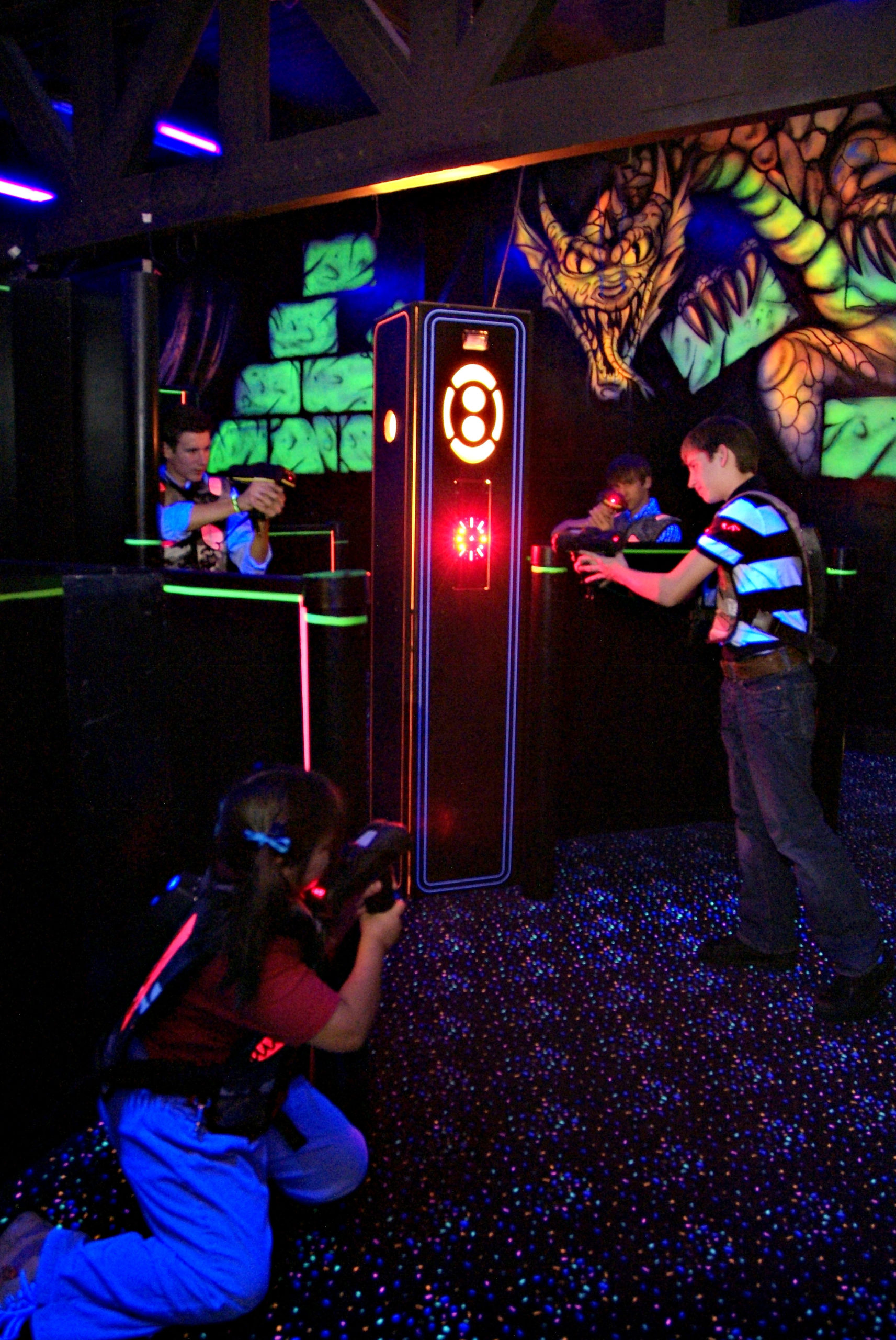 group playing a game of laser tag